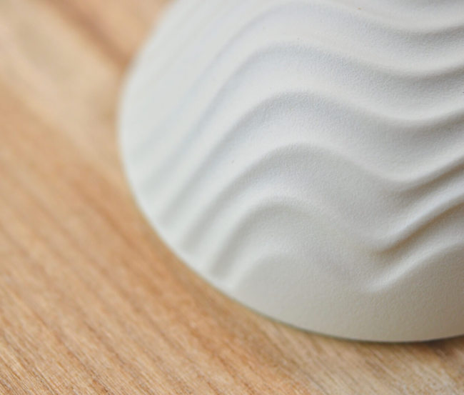 Medium DomeSeashell with contours reminscent of windswept sand, or lines of ocean swell